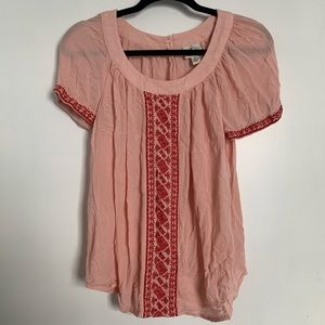 Flowy pink top with embroidered sleeves